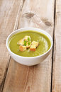 Spinach soup with dried crusts on wooden table rustic Stock Photos