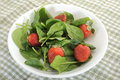 Spinach and strawberries close up images of salad with Stock Images