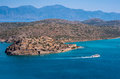Spinalonga island crete greece aerial view of the of with a ferry boat passing taken from the hills above plaka Royalty Free Stock Images