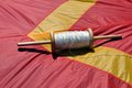 Spindle a with white thread to fly kites Stock Image
