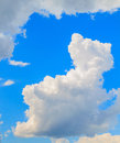Spindrift clouds on blue sky background a sunny day against the clear Stock Photography
