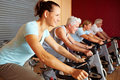 Spinning class doing exercises Royalty Free Stock Images
