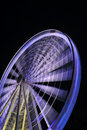 Spinning ferris wheel at night Stock Images