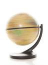 Spinning globe against white background Royalty Free Stock Photos