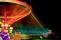 Spinning light painting with a luna park Royalty Free Stock Image