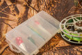 spinning lures in the box and fishing reel Royalty Free Stock Photo