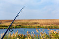 Spinning rod and lake freshwater stationery fishing Stock Photos