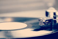 Spinning vinyl record. Motion blur image. Royalty Free Stock Photography