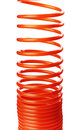 Spiral air hose orange red thin used for pneumatic tools Royalty Free Stock Image