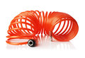 Spiral air hose orange red thin used for pneumatic tools isolated on white with natural reflection Royalty Free Stock Photos