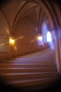 Spiral cool wide helical staircase with effect light in windows round walls and the walls of a historic gothic castle boynetse Royalty Free Stock Image