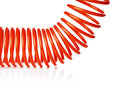 Spiral hose orange red thin air used for pneumatic tools isolated on white with natural reflection Stock Image