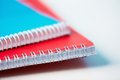 Spiral notebooks macro shot of a pile of of bright colors Stock Images