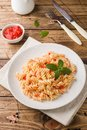 Spiral pasta mixed with cherry tomatoes and tomato sauce on a plate Royalty Free Stock Photo