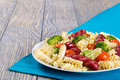 Spiral Pasta salad with  broccoli and grilled sausages , close u Royalty Free Stock Photo