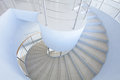 Spiral staircase in office hall Royalty Free Stock Images