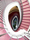 Spiral staircase, red carpet Royalty Free Stock Photo