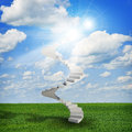 Spiral stairs in sky with green grass, clouds and Royalty Free Stock Photo