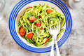 Spiralled courgette with green pesto and cherry tomatoes Royalty Free Stock Photo