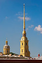 Spire of the cathedral main petropavlovskaya fortress background blue sky Stock Photos