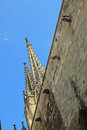 Spires and gargoyles on stone wall of church in Barcelona Royalty Free Stock Photo