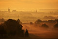 Spires in the mist towers and of a small european town silhouetted against morning sunrise Royalty Free Stock Photography