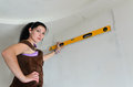 Spirit level low angle shot of female carpenter working with Royalty Free Stock Images