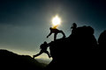 Spirited amateur climbers to support the summit Royalty Free Stock Image