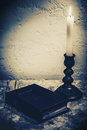 Spiritual abstract still life with holy bible on the desk and burning candle Royalty Free Stock Image