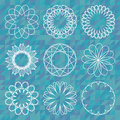 Spirograph round ornament set over polygonal background Royalty Free Stock Photo