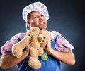 Spiteful man with teddy bear in studio Royalty Free Stock Photography