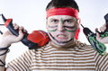 Spiteful man in war paint with two drills Stock Photos