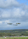Spitfire aircraft flying in formation over Southern England. Royalty Free Stock Photo