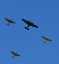Spitfire aircraft flying in formation over Southern England with a single Bristol Blenheim bomber. Royalty Free Stock Photo
