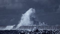 Splash of a big stormy ocean wave against pier from the north portugal used infrared filter toned blue Stock Images