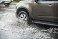 Splash by a car as it goes through flood water Royalty Free Stock Photo
