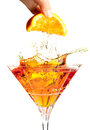 Splash cocktail with orange Royalty Free Stock Images