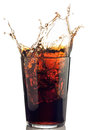 Splash of cola with ice cubes Stock Photos