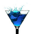 Splash in a glass of blue alcohol with ice cubes close-up  on white Royalty Free Stock Photo