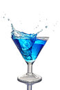 Splash in glass of a blue alcoholic cocktail drink with ice Royalty Free Stock Photo