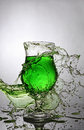 Splash in glass of green alcoholic cocktail drink Royalty Free Stock Photo