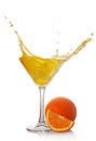 Splash in glass of yellow alcoholic cocktail drink with orange Royalty Free Stock Photo