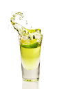 Splash of tequila from the falling pieces of lime Royalty Free Stock Photo