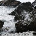 Splash of waves about coastal stones Stock Photos