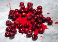 Splashed sour cherries on metallic surface sour cherry fruits Royalty Free Stock Photo