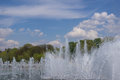 Splashes of the fountain and rainbow in city park Stock Image