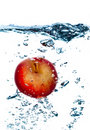 Splashing apple. Stock Photos