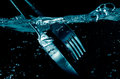 Splashing  Fork and  Knife in water Royalty Free Stock Photo