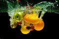 Splashing Fresh fruit and Vegetables Royalty Free Stock Photo