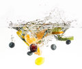 Splashing fruit on water fresh white background Stock Photography